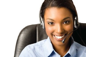 A lady smiling with headsets